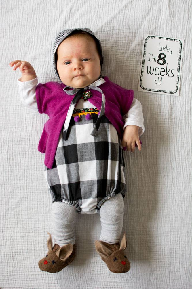 Celina from Petit a Petit's romper, hat and cardigan