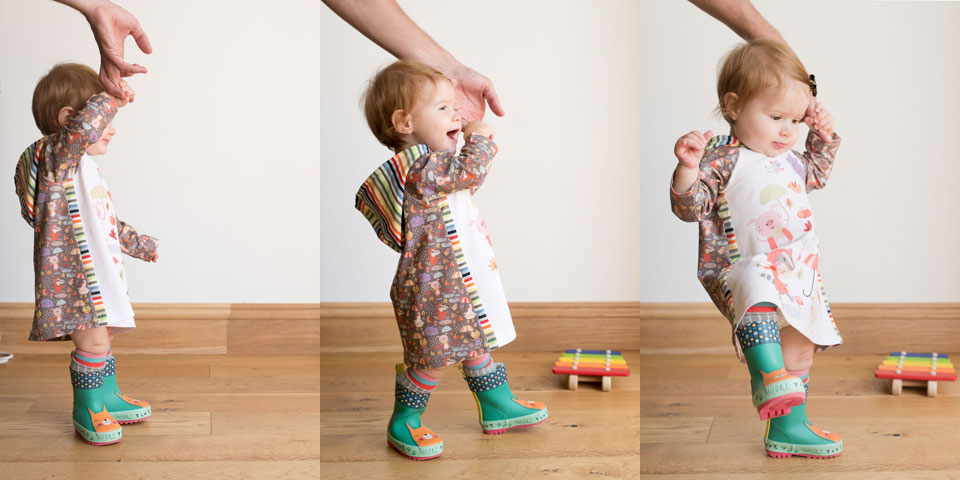 Rainy days rainbow dress. A mashup of the Safari Raglan dress with the Rowan Tee hood, patterns by Titchy Threads.