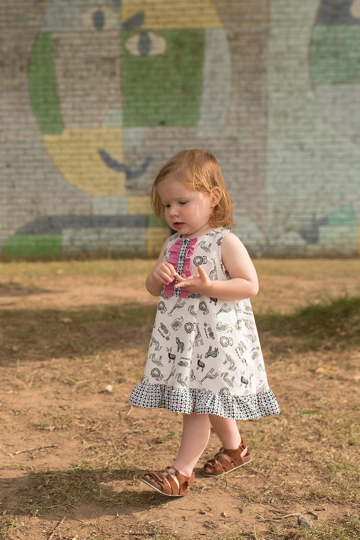 Wee wanders Rushbrook dress with ruffle placket and ruffle hem