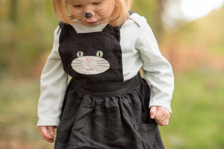 Black cat pinafore bib close up